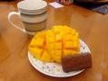 A proper Australian snack! Tim-tams, mango, and tea!