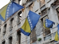 Bosnian Flag and a bombed out building of Mostar.