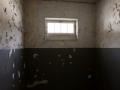 """A prison cell in the """"bunker"""" at Dachau."""