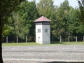Guard tower and fence at Dachau.