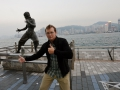 Posing with the Bruce Lee statue in Hong Kong. He never picked up om the deadly double-thumbs-up.