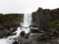 Waterfall in the rift between the two contenential plates in Þingvellir National Park, Iceland.