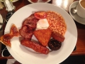 A full Irish breakfast. The beans, hashbrowns, bacon, egg and those black things on the bottom right are good. The sausage is total crap and disgusting.