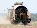 For some reason this farmer was destroying all of his watermelons with this large machine.