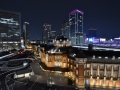 Tokyo Station all lit up at night.