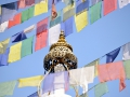 Prayer flags and a temple in Kathmandu.