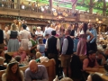 It's standing on the tables and dance time at this Octoberfest tent.