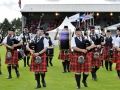 Bagpiping band at the Highland Games in Dunoon,  Scotland.