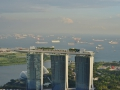 Closeup of the casino and all the container ships in Singapore.