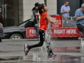 A girl having fun in the fountains of Yonge Dundas Square.