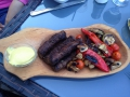 Grilled vegetables and a mixed meat sausage thing are very common and delicious.