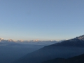 Sunrise in the Himalaya. The mountains in the center of the photo are in Tibet.