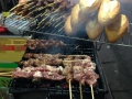 Meat being grilled for bahn mi.