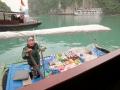 A very entreprenerial woman in Ha Long Bay.