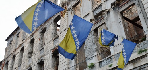 Bosnian-Flag-and-a-bombed-out-building-of-Mostar